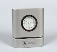 Silver colored SPVM Quartz clock.